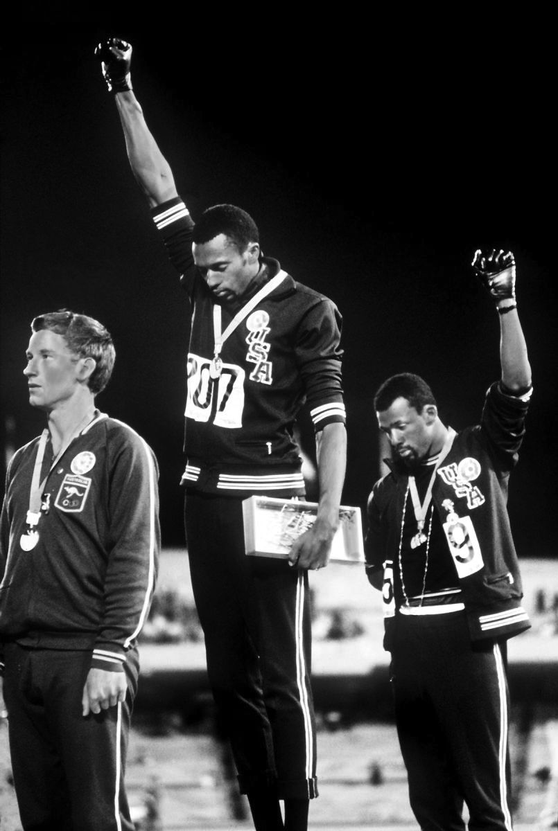 During the 1968 Olympics, in Mexico, Tommie Smith and John Carlos raise their fists during the USA national anthem
